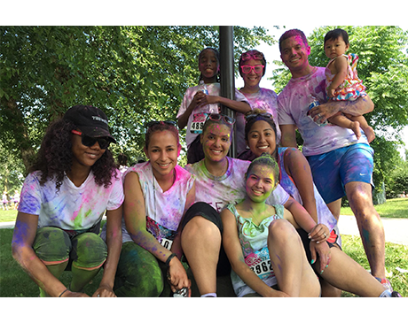 Dental team members covered in paint after a fun run event