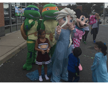 Peopld dressed as cartoon characters at a community event