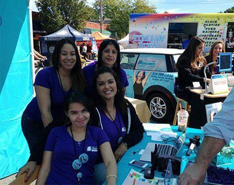 Four Meadowbrook Dental Care team members at community event