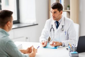 dentist talking to a diabetic patient about dental implants